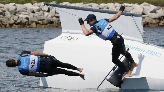 New Zealand's Peter Burling and Blair Tuke celebrate winning silver in the 49er sailing class at the London 2012 Olympic Games