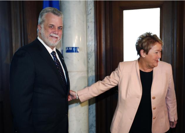 Philippe Couillard and Pauline Marois attend a photo-op at the National Assembly in Quebec City