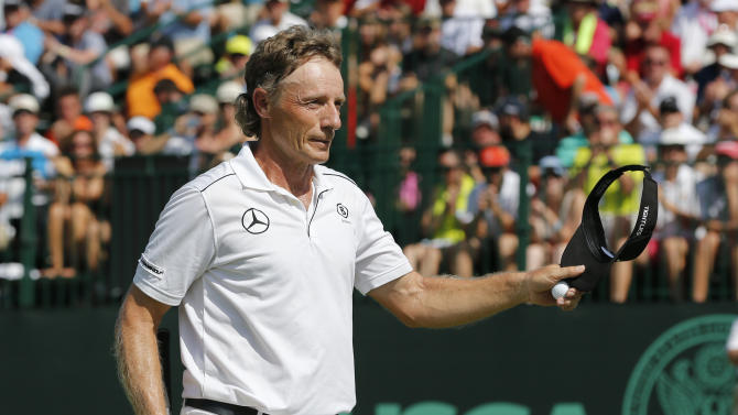 Langer wins Senior British Open by record 13 shots