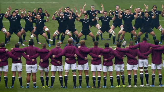 England's players look on as New Zealand's players perform Haka before international rugby union match at Twickenham in London