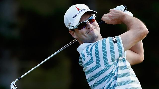 Golf - Sharp wedge game helps Johnson take control in Hawaii