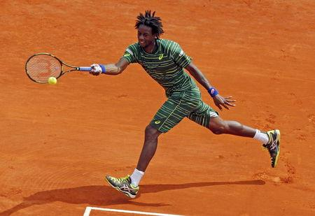 Monfils of France returns the ball to Berdych of the Czech Republic during their men's singles semi-final tennis match at the Monte Carlo Masters in Monaco