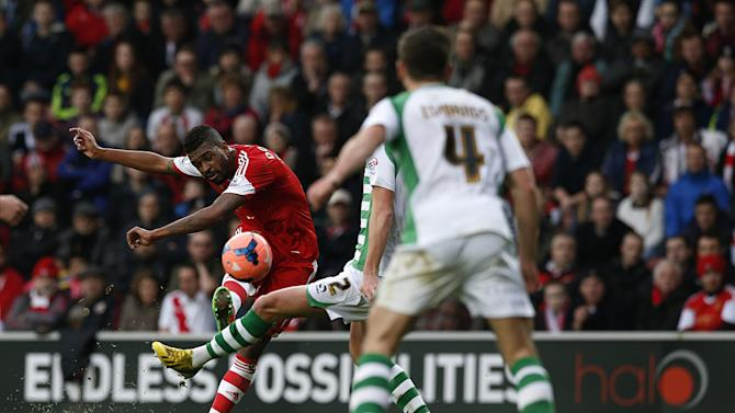 Southampton's Guly Do Prado, left, has a shot at goal as Yeovil Town's Luke Ayling, center, partially seen, attempts to block, during their FA Cup fourth round soccer match at St Mary's, Southampton, England, Saturday, Jan. 25, 2014