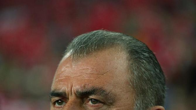 Turkey's coach Fatih Terim watches the game during their World Cup Group D qualifying soccer match with Netherlands at Sukru Saracoglu Stadium in Istanbul, Turkey,  Tuesday, Oct. 15, 2013. (AP Photo)