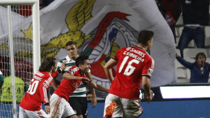 Benfica's Nicolas Gaitan celebrates his goal against Sporting with teammate Lazar Markovic and Guilherme Siqueira during their Portuguese Premier League soccer match at Luz stadium in Lisbon