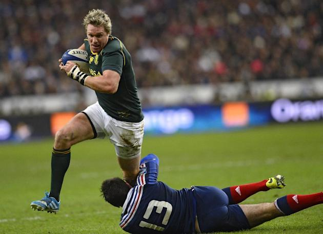 South Africa's centre and captain Jean De Villiers (left) is tackled by France's centre  Florian Fritz  during the rugby union test match France vs South Africa at the Stade de France in Saint Den