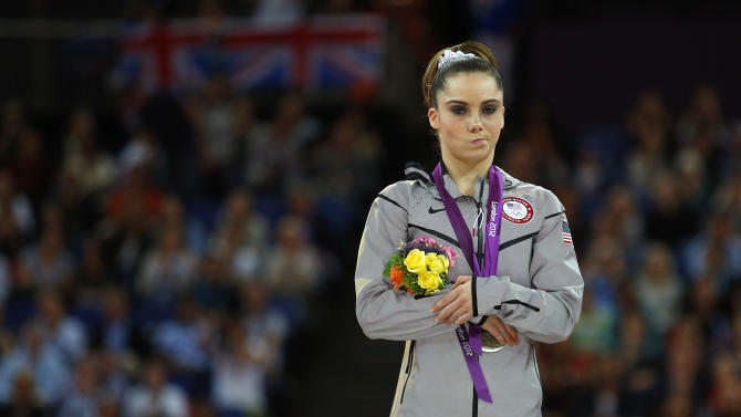 McKayla Maroney of the U.S. celebrates with her silver medal in the women's vault victory ceremony in the North Greenwich Arena during the London 2012 Olympic Games