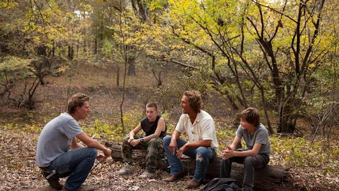 """This film publicity image released by Roadside Attractions shows director Jeff Nichols, from left, with actors, Tye Sheridan, Matthew Mc Conaughey and Jacob Lofland on the set of """"mud."""" Nichols fashions a Mark Twain-esque Mississippi River tale with some big Hollywood names, including Matthew Mc Conaughey and Reese Witherspoon. (AP Photo/Roadside Attractions, Jim Bridges)"""