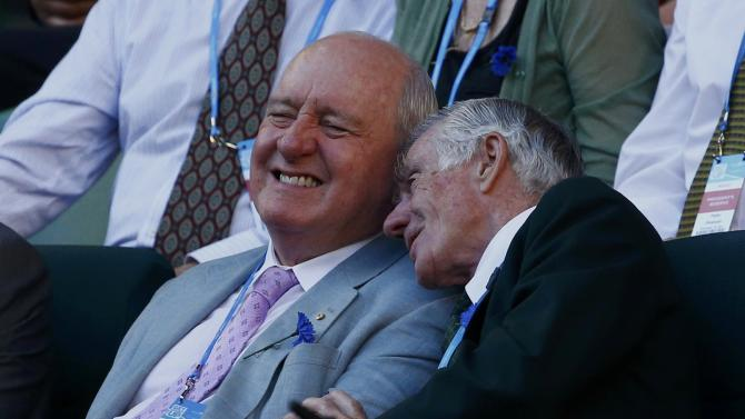 Radio broadcaster and former Australian national rugby union coach Alan Jones sits with former Australian tennis player Ken Rosewall at the Australian Open 2014 tennis tournament in Melbourne