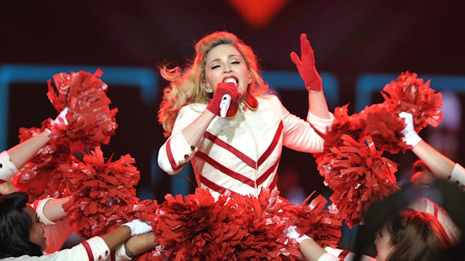 "FILE - This Oct. 10, 2012 file photo shows Madonna performing on the ""MDNA"" tour at Staples Center in Los Angeles. Some Colorado fans are upset after music superstar Madonna used guns during a performance. Madonna started her show Thursday, Oct. 18, at the Pepsi Center in Denver with a gun scene, which she has used in previous performances. TV station KUSA  received several calls Friday from concert-goers saying they were offended she used guns and violence as part of her show in light of recent events in the state that included a mass shooting at a theater during a Batman movie on July 20 that left 12 people dead. (Photo by John Shearer/Invision/AP, file)"