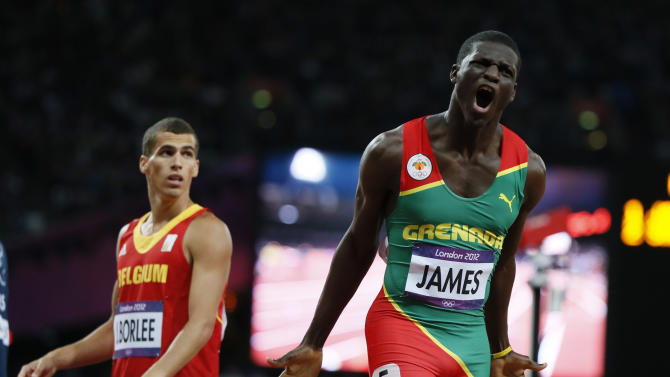 Grenada's Kirani James reacts next to Belgium's Jonathan Borlee after winning the men's 400m final at the London 2012 Olympic Games at the Olympic Stadium