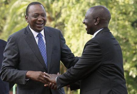 Kenya's President Uhuru Kenyatta (L) shares a moment with his Deputy William Ruto (R) at the State House after Kenyatta's case at the International Criminal Court (ICC) was dropped in the capital Nairobi, December 5, 2014. REUTERS/Thomas Mukoya