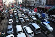 Bangladeshi commuters sit in traffic jam along a main road in Dhaka on August 14, 2012. Bangladesh on Wednesday signed a loan deal with a Japanese development agency for construction of the country's first-ever metro rail system, costing $2.8 billion and intended to ease Dhaka's traffic jams
