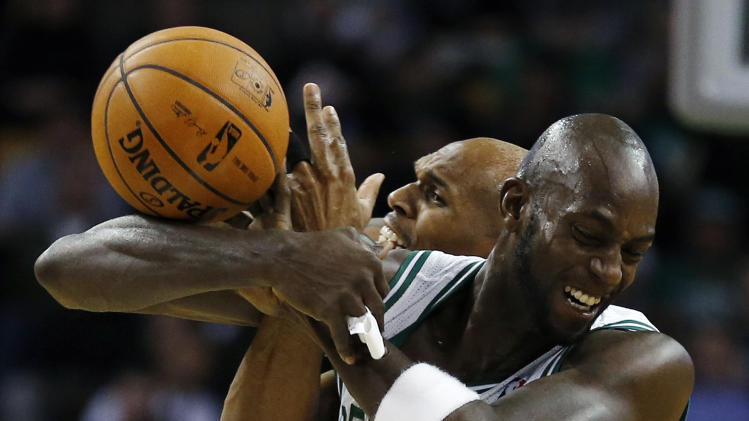 Boston Celtics' Kevin Garnett, right, and Brooklyn Nets' Jerry Stackhouse battle for a loose ball in the second quarter of an NBA basketball game in Boston, Wednesday, Nov. 28, 2012. (AP Photo/Michael Dwyer)