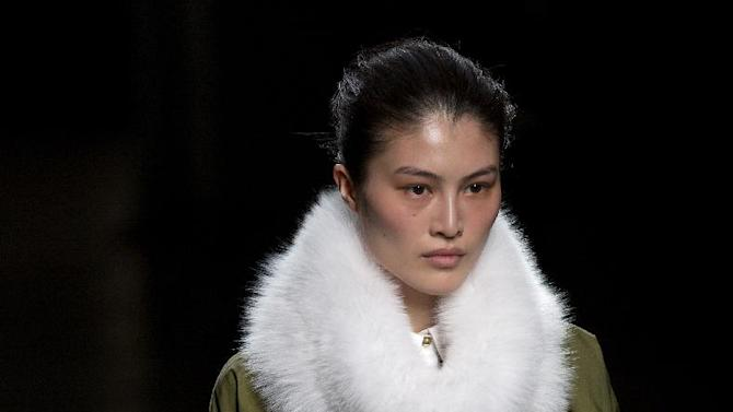 A model walks the runway at the presentation of the Prabal Gurung Fall 2013 fashion collection during Fashion Week, Saturday, Feb. 9, 2013, in New York. (AP Photo/Craig Ruttle)