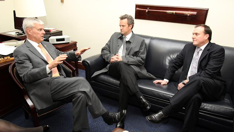 National Association of Drug Court Professionals 'All Rise Ambassador' Actor Matthew Perry, center, and CEO West Huddleston, right, discuss funding for Drug Courts and Veterans Treatment Courts with Congressman Steve Womack (R-AR) on March 21, 2013 in Washington, DC. (Paul Morigi / AP Images for The National Association of Drug Court Professionals)