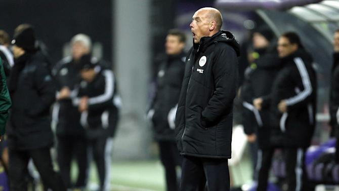 Wigan coach Uwe Rosler grimaces during their group D Europa League soccer match against Maribor, in Maribor, Slovenia, Thursday, Dec. 12, 2013