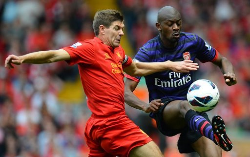 Liverpool midfielder Steven Gerrard (left) vies with Arsenal's Abou Diaby during the Premier League match between Liverpool and Arsenal at Anfield in Liverpool. Arsenal ended their goal drought in emphatic fashion as Lukas Podolski and Santi Cazorla inspired an impressive 2-0 win at Liverpool