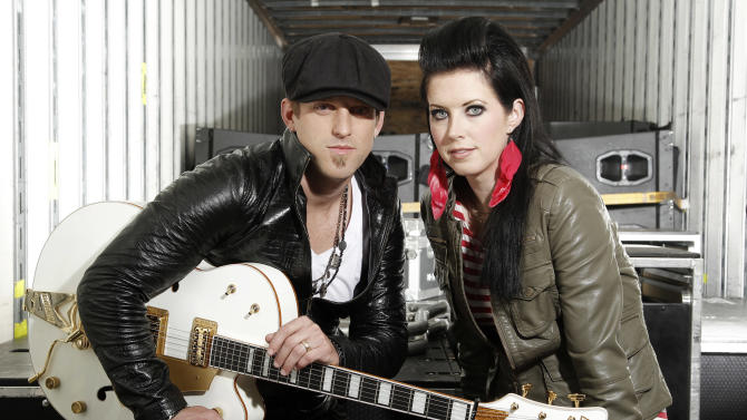 FILE - In this Oct. 27, 2011 file photo, musicians Keifer Thompson, left, and Shawna Thompson, of the group Thompson Square, pose for a portrait in Los Angeles. The husband-and-wife duo Thompson Square is The Academy of Country Music's vocal duo of the year. The win was announced Saturday night March 31, 2012 during the ACM Salute to the Military concert in Las Vegas. Academy executive director Bob Romeo surprised Shawna and Keifer Thompson on stage with the news.  (AP Photo/Matt Sayles)
