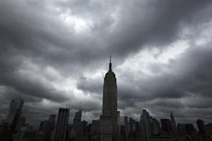 Storm clouds pass over the top of the Empire State Building in New York