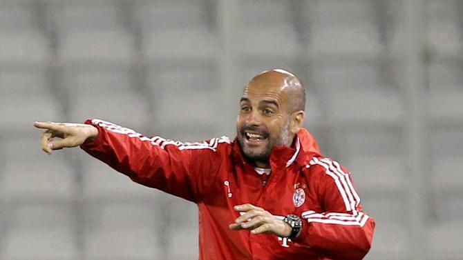 Bayern Munich's coach Pep Guardiola reacts from the sidelines during his team's friendly soccer match against  Al-Merrikh, at Al-Saad stadium in Doha Thursday, Jan. 9, 2014