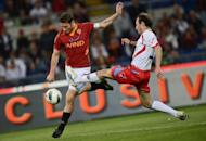 AS Roma's forward Francesco Totti (L) fights for the ball with a Catania player during an Italian Serie A football match at Rome's Olympic stadium. Roma all but crashed out of European contention with a limp performance in a 2-2 draw at home to Catania