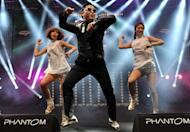 """South Korean singer Psy (L) performs his hit single """"Gangnam Style"""" during a concert in Istanbul on February 22, 2013. YouTube will livestream a debut concert performance of Psy's hugely anticipated follow-up to his global hit """"Gangnam Style,"""" the South Korean sensation announced in a teasing video message"""