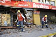 Talca City Hall workers repair the power supply of the city in 2010. A 7.2 magnitude earthquake struck central Chile Sunday, in an area hit by an 8.8 earthquake in 2010, the US Geological Survey said