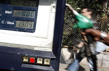 An attendant prepares to refuel a car at a petrol station in downtown Rome March 13, 2012. REUTERS/Tony Gentile