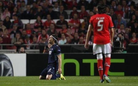 AZ Alkmaar's Nemanja Gudelj kneels on the pitch during their Europa League quarter-final second leg soccer match against Benfica at Luz stadium in Lisbon