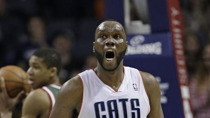 Charlotte Bobcats' Al Jefferson (25) reacts after making a basket and being fouled by the Milwaukee Bucks during the second half of an NBA basketball game in Charlotte, N.C., Monday, Dec. 23, 2013. The Bobcats won 111-110 in overtime