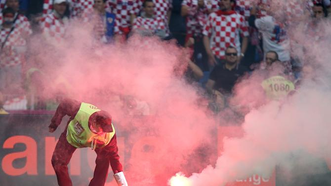 Croatia fans have cost their county 80,000 euros following racial abuse and the throwing of lit fireworks against Italy