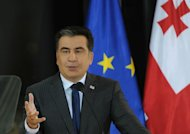 "Georgian President Mikheil Saakashvili speaks in Tbilisi , on February 8, 2013. He made an emotional appeal for peaceful ""cohabitation and cooperation"" with the ruling coalition after an angry mob attacked his allies"