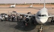 Armed Militia Storms Tripoli Airport Runway