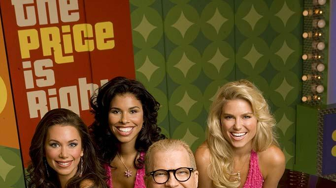 Host Drew Carey, shown with The Price is Right models (from right) Brandi Sherwood, Gwendolyn Osborne and Rachel Reynolds, on The Price is Right.