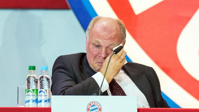 """Uli Hoeness, president of German soccer club FC Bayern Munich, cries during the annual club meeting in Munich, southern Germany, Wednesday, Nov. 13, 2013. Hoeness will have to go on trial next March to face tax evasion charges over a Swiss bank account, and Bayern has reaffirmed its backing for the 61-year-old following his """"outstanding services"""" to the club"""