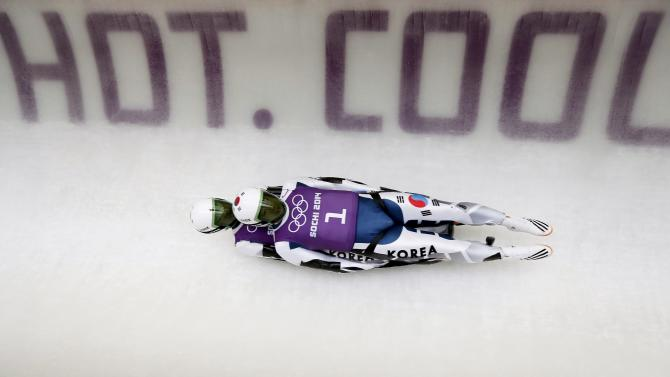 South Korea's Park and Cho speed down the track during a men's doubles luge training session at the 2014 Sochi Winter Olympics in Rosa Khutor