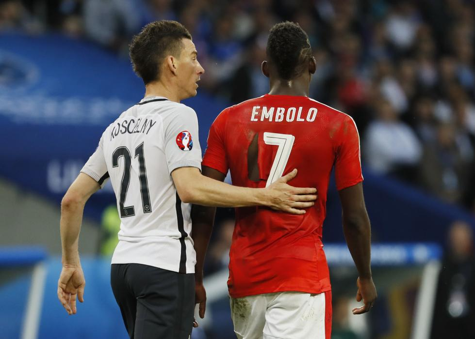 France's Laurent Koscielny and Switzerland's Breel Embolo with a ripped shirt