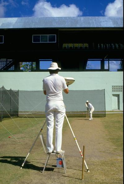 1986:  Bob Willis of England stands at the bowling machine while team mate Ian Botham bats in a training session before the Third Test match against the West Indies at the Kensington Oval in Bridgetow