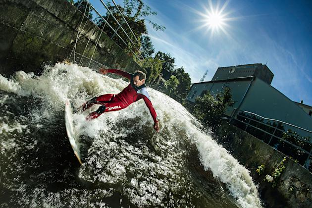 Surfer Peter Bartl braves the waves in Austria for his photographer friend Philip Platzer (Caters)