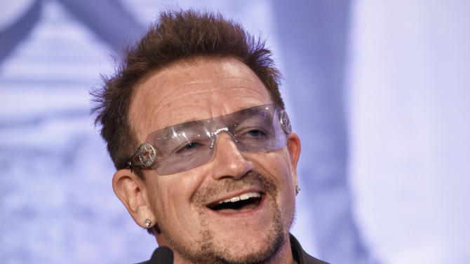"""FILE - In this Friday, May 18, 2012 file photo, Bono, the Irish rock star and activist, speaks at the Symposium on Global Agriculture and Food Security following an appearance by President Barack Obama at the Ronald Reagan Building in Washington. It appeared Bono and arachnids didn't mix when his """"Spider-Man"""" musical had a rough Broadway run, but that didn't keep a biologist from naming an actual spider species after the U2 singer. Jason Bond of Auburn University has identified 33 new species of trapdoor spider, including three of them in the California desert at Joshua Tree National Park. The park's namesake is featured in the title and cover of U2's 1987 album, """"The Joshua Tree."""" (AP Photo/J. Scott Applewhite, File)"""