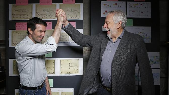 """In this photo taken Wednesday, Mar. 20, 2013, Nolan Bushnell, the founder of Atari, right cheers his son, Brent Bushnell, CEO of   """"Two-Bits-Circus,""""  a Los Angeles idea factory focused on software, hardware and machines. Nolan Bushnell was the first guy to give Steve Jobs his first full-time job in Silicon Valley at Atari. Two Bit Circus is a unique hybrid of intellectuals, creatives and performers. (AP Photo/Damian Dovarganes)"""