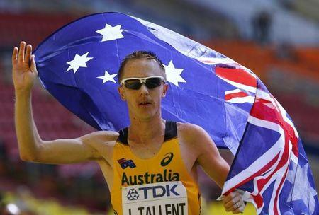 Tallent of Australia celebrates finishing third in the men's 50 km race walk final during the IAAF World Athletics Championships in Moscow