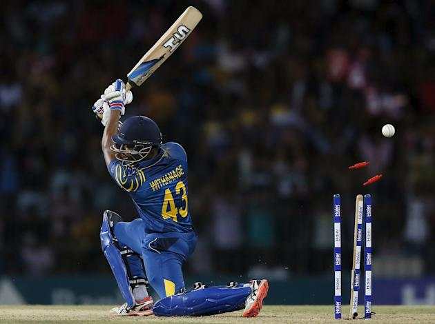 Sri Lanka's Vithanage is bowled out by Pakistan's Tanvir during their first Twenty 20 cricket match in Colombo