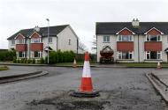 A traffic cone marks a raised manhole cover on the Glenall housing estate in the village of Borris-in-Ossory, County Laois, Ireland February 13, 2013. REUTERS/Cathal McNaughton