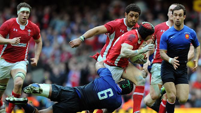 Wales full back Leigh Halfpenny (3R) is tackled by France's captain Thierry Dusautoir during the 6 Nations International rugby union match between Wales and France at the Millenium stadium in Cardiff, on March 17, 2012.. AFP PHOTO / FRANCK FIFE  RESTRICTED TO EDITORIAL USE. (Photo credit should read FRANCK FIFE/AFP/Getty Images)