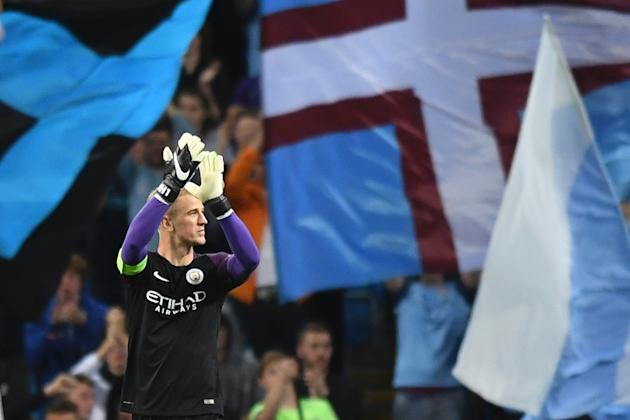 Manchester City's English goalkeeper Joe Hart gestures to the crowd after the UEFA Champions League second leg play-off football match between Manchester City and Steaua Bucharest  on August 24, 2