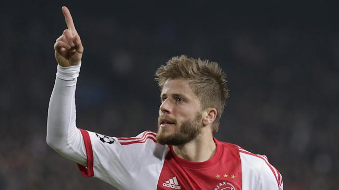 Ajax's Lasse Schone celebrates scoring 1-0 against Celtic during the Champions League Group H soccer match between Ajax Amsterdam and Celtic Glasgow at ArenA stadium in Amsterdam, Netherlands, Wednesday, Nov. 6, 2013