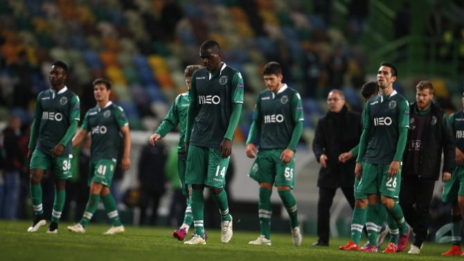 Sporting's players leave the pitch after their Europa League round of 32 second leg soccer match against Wolfsburg at Alvalade stadium in Lisbon