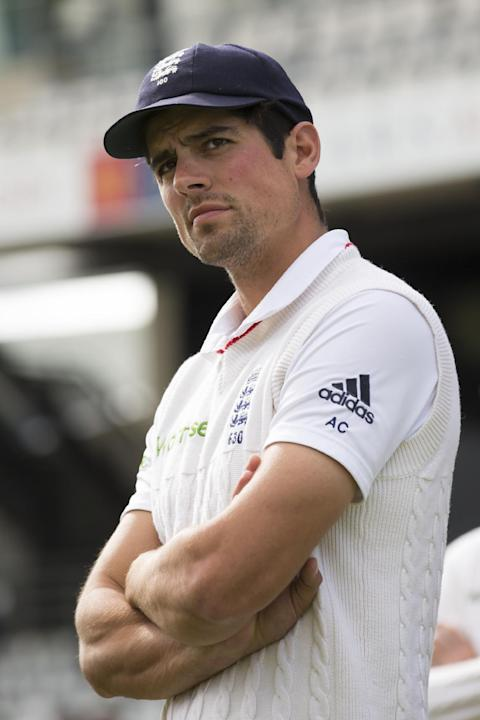 England's captain Alastair Cook stands on the pitch after his side are beaten on the fifth day of the second Test match between England and New Zealand at Headingley cricket ground in Leeds, Engla